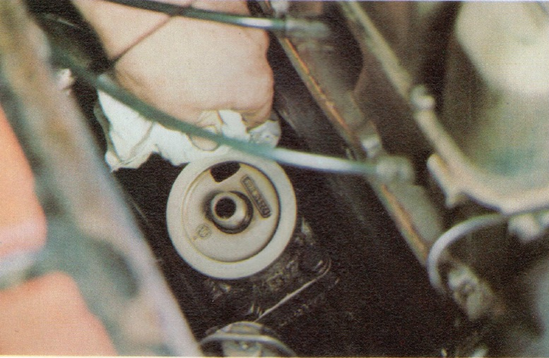 Prepare the oil filter mounting on a Classic Car