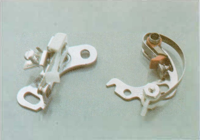Two one-piece contact sets. They are of different manufacture and, because of their shape, are not interchangeable